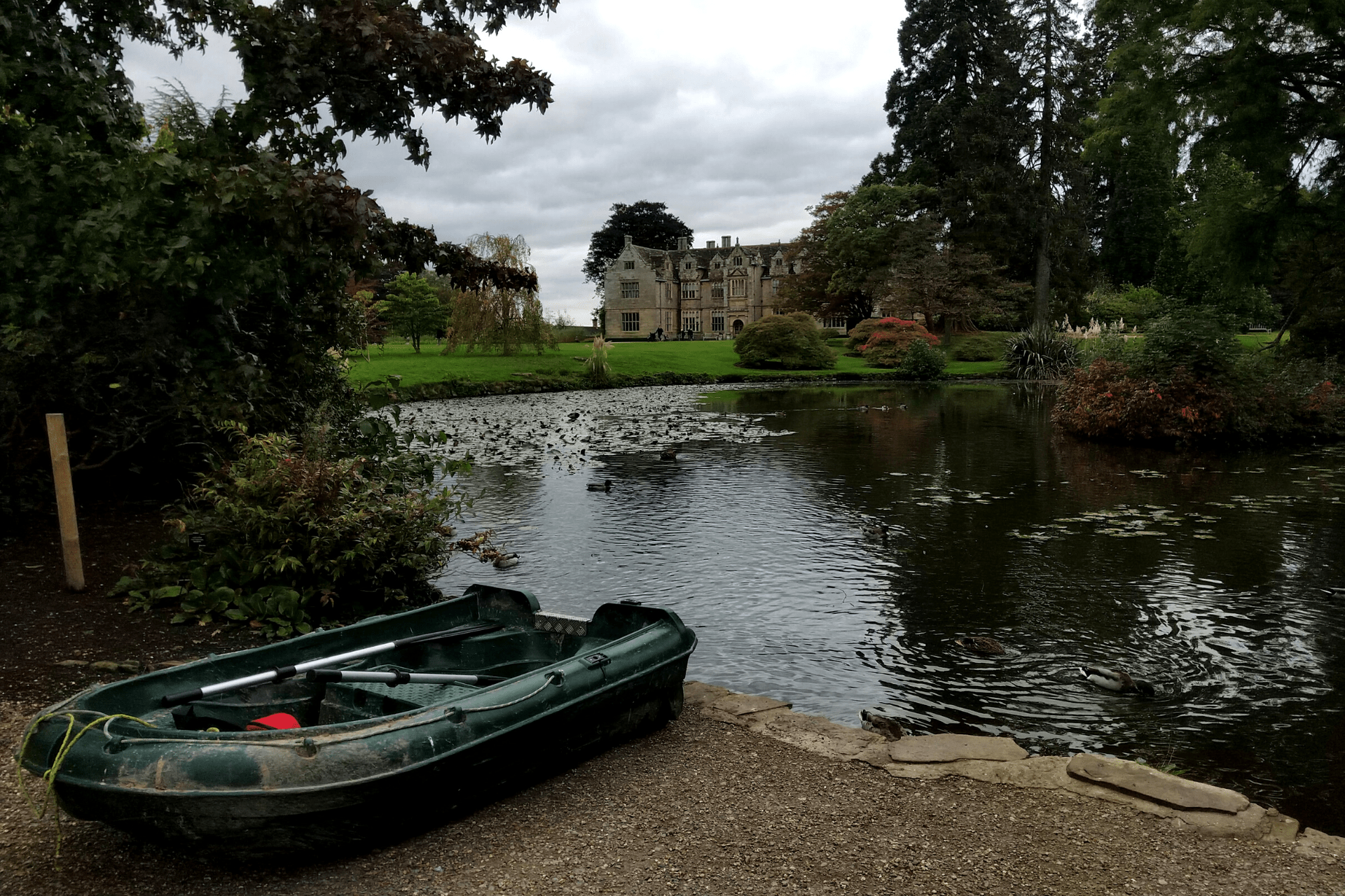 The view across the lake towards the Elizabethan manor at Wakehurst