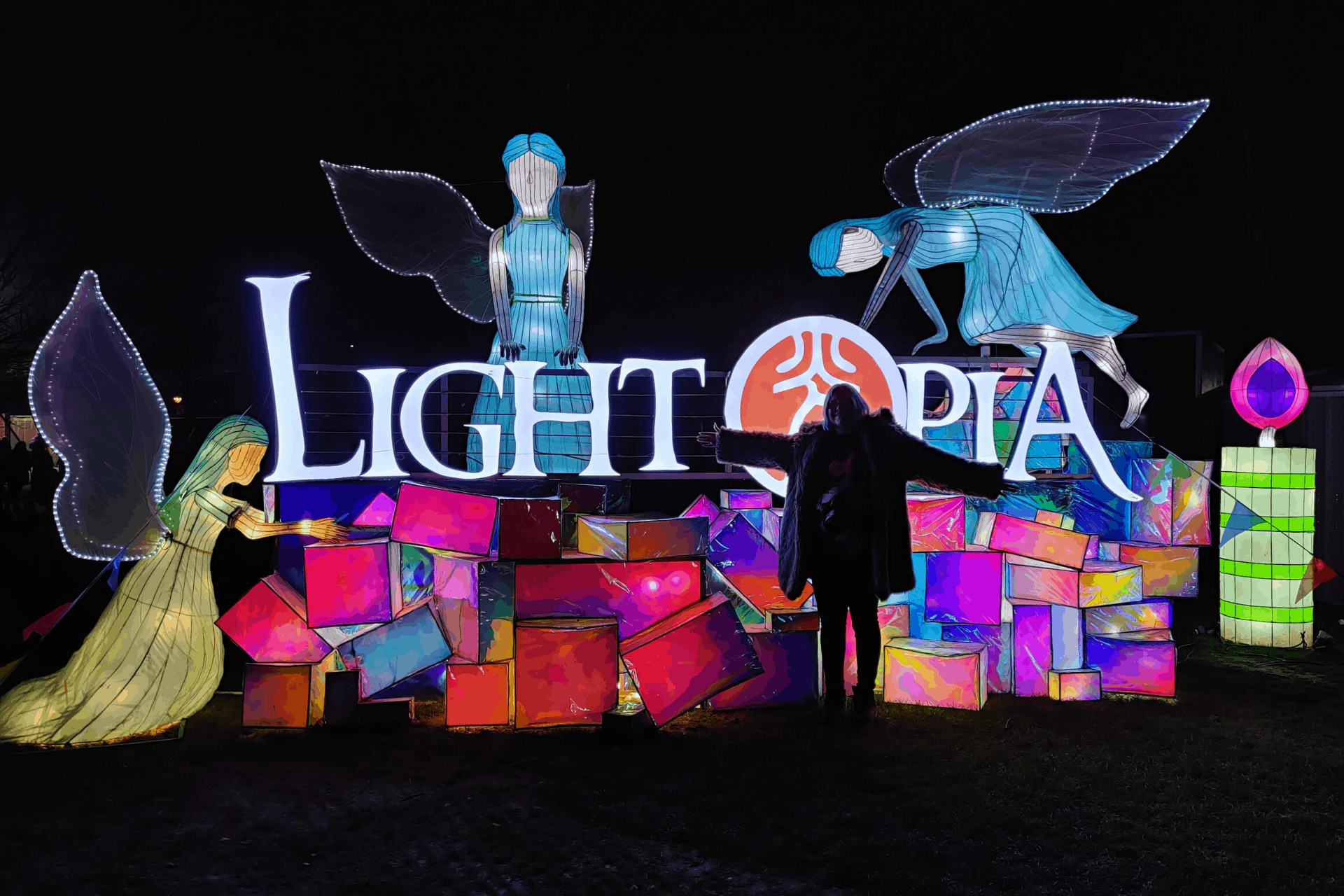 A picture of me (Claire!) at the entrance to Lightopia festival at Chiswick House