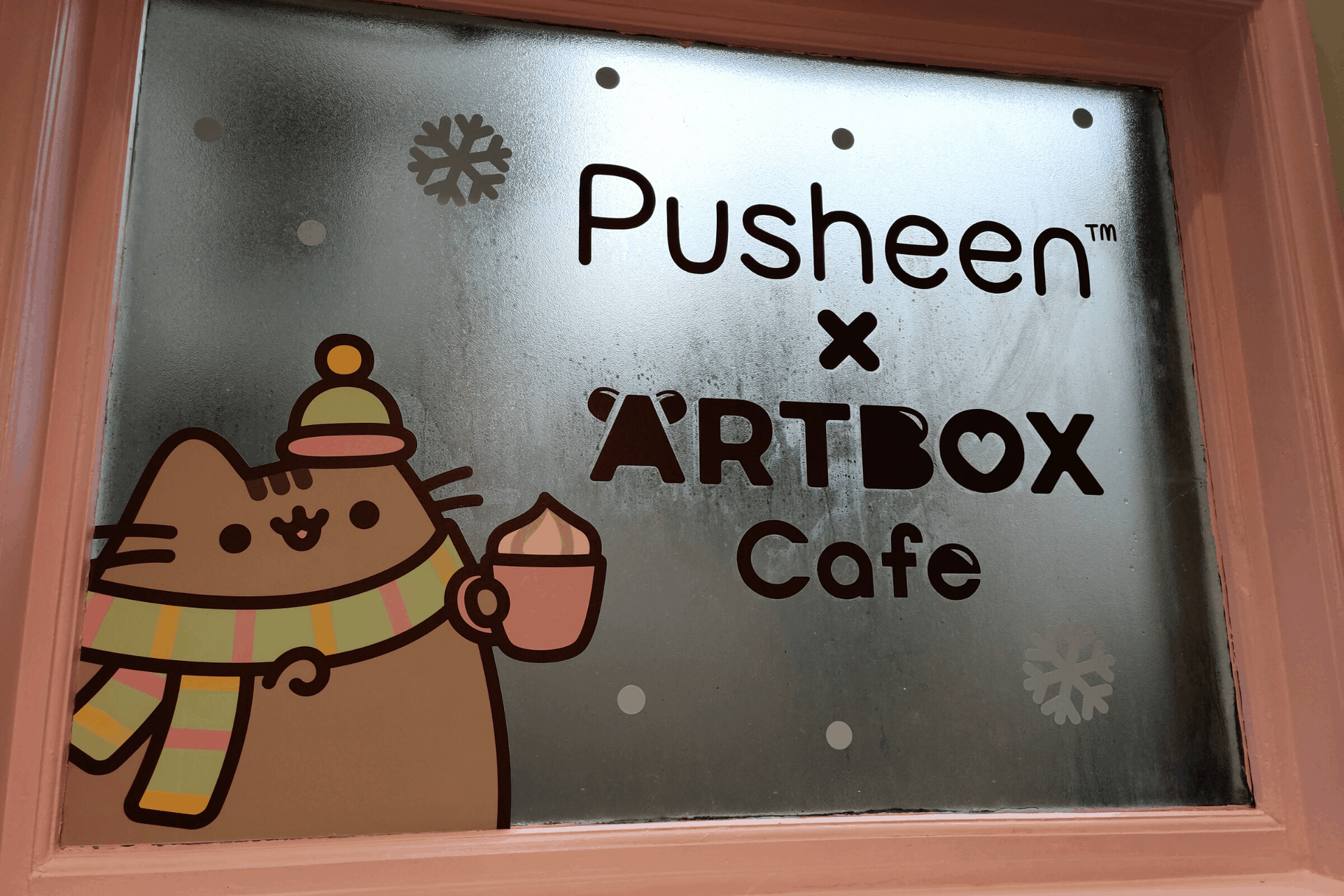 The window in the stairwell at the Pusheen cafe