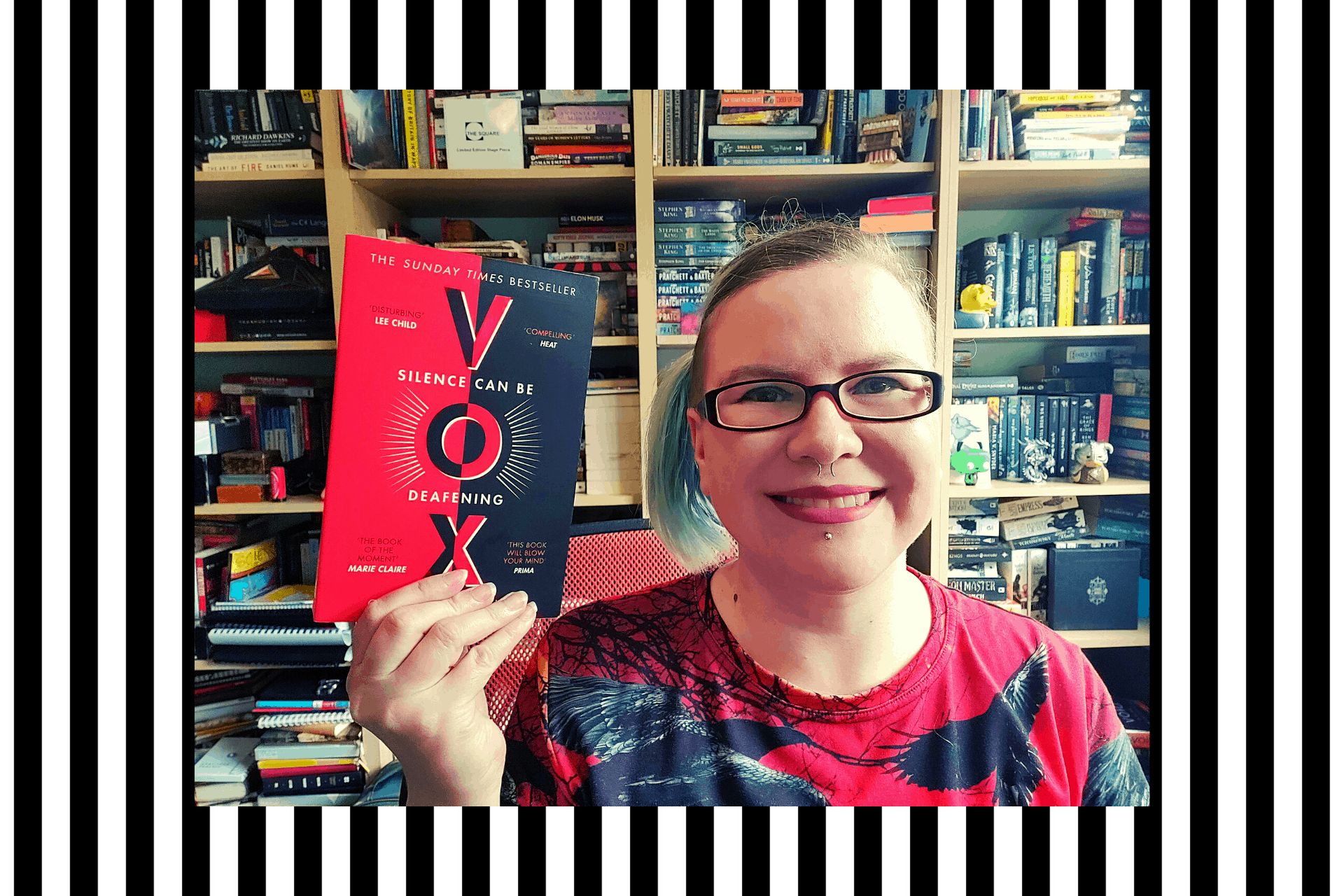Claire holding VOX by Christina Dalcher, just one of the books read on the week of 22nd June 2020