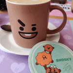 Shooky Caramel Latte and coaster at ARTBOX Cafe in Brighton